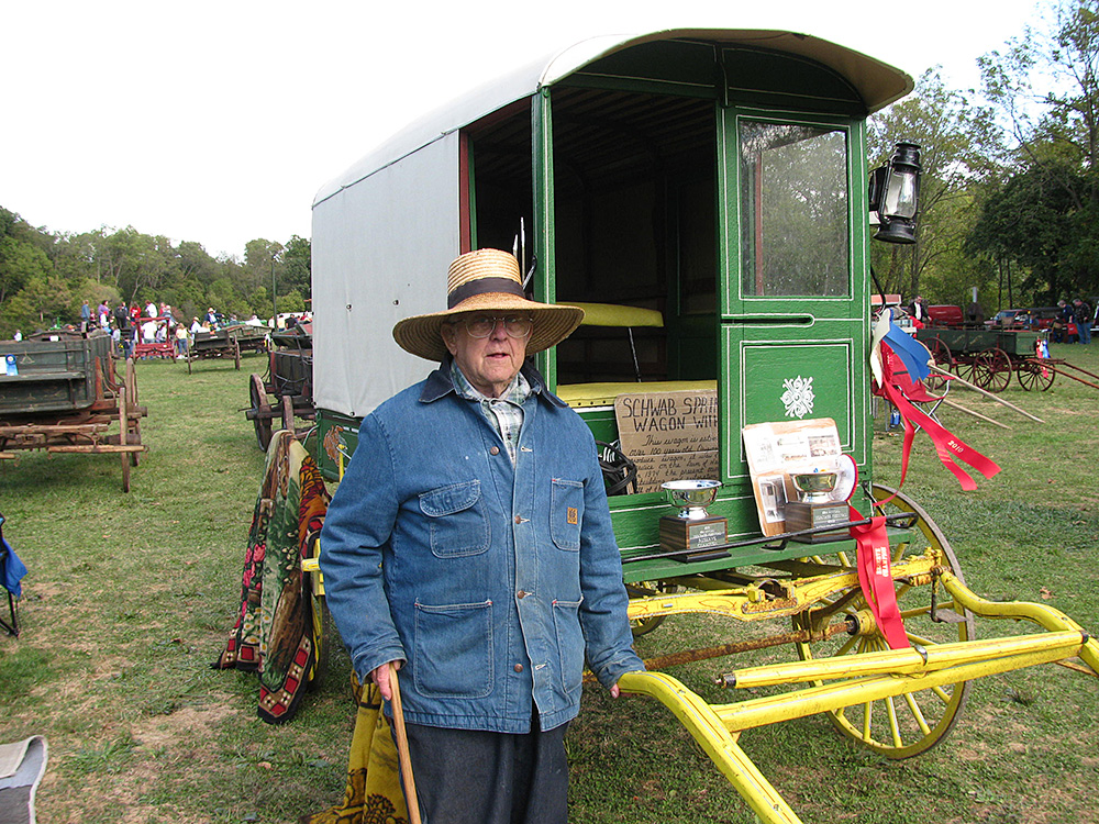 Mervin Moyer with his award winning market wagon on display at the Berks Heritage Center.